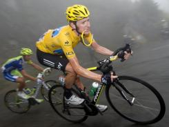 Bradley Wiggins, wearing the yellow jersey of the overall leader, ascends the mountains during the 89-mile ride from the southwestern town of Bagneres-de-Luchon to the ski station of Peyragudes.
