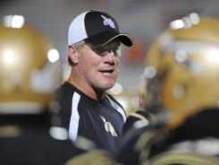 Favre speaks with Oak Grove players in 2011, when he served as a volunteer coach.