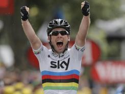 Mark Cavendish of Britain crosses the finish line to win the 18th stage of the Tour de France cycling race on Friday.