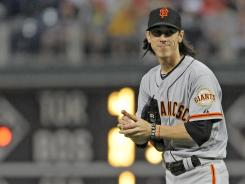 Giants starter Tim Lincecum smiles as began to look like the pitcher of of old, allowing five hits and striking out six against the Phillies.