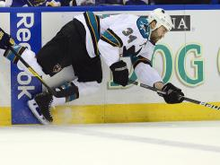 Daniel Winnik, getting tripped up by St. Louis Blues right wing B.J. Crombeen , played with both Colorado and San Jose last season.