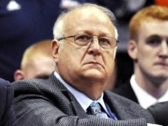 Syracuse basketball assistant coach Bernie Fine, who has been at the center of sex-abuse allegations, is shown watching a college basketball game against Manhattan in Syracuse, N.Y.