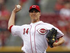 Cincinnati starting pitcher Homer Bailey matched a career high with 10 strikeouts in 3-1 victory over Milwaukee.