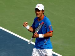 Go Soeda of Japan celebrates his victory over fellow countryman Kei Nishikori during the BB&amp;T Atlanta Open.