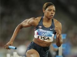 Crystal Cox, shown running a heat of the 4x400-meter relay at the 2004 Athens Olympics, had her medal stripped due to doping. She did not run in the final, which the U.S. won with a time of 3:19.01.