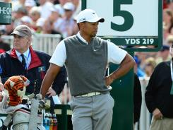 Tiger Woods waits to tee off on the fifth hole on the way to shooting a third-round 70 at the British Open.