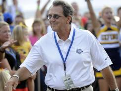 Former Michigan coach Lloyd Carr is introduced to the crowd at the College Hall of Fame blazer presentation.