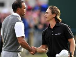 Tiger Woods shakes hands with 22-year-old Thorbjorn Olesen of Denmark on the 18th green after their round at Royal Lytham & St. Annes.