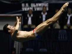 Nick McCrory dives off the 10-meter platform in the U.S. Olympic team trials in June.