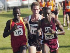 In this 2008 file photo, Iowa State's Guor Marial during the Big 12 cross country meet at Iowa State's Cross Country Course in Ames, Iowa. His hometown is now part of South Sudan, but that nation doesn't have an Olympic team. He qualified for the Olympic marathon, but can't compete for the United States because he's not yet a citizen.