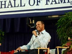 National Baseball Hall of Fame inductee Barry Larkin speaks at an media conference in Cooperstown, N.Y., on Saturday. He and the late Ron Santo will be enshrined on Sunday.
