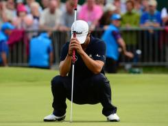 Adam Scott misses a par putt on the 18th hole that would have put him in a playoff with Ernie Els. Scott bogeyed the final four holes of the British Open.