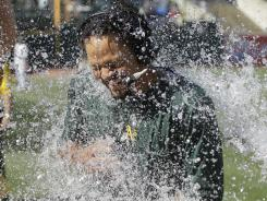 Coco Crisp is doused after his game-winning walk-off single in the bottom of the 12th.
