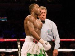 Adrien Broner, seen here in February, was stripped of his belt on Friday for weighing in three points overweight, but won Saturday to improve to 24-0.