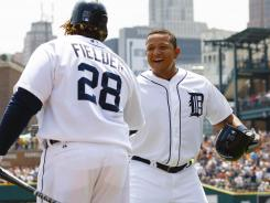 Tigers' Miguel Cabrera receives congratulations from Prince Fielder after hitting a home run in the first inning.