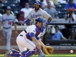 Matt Kemp comes around to score on Matt Treanor's two-run single in the 12th inning, which gave the Dodgers a 5-3 lead.