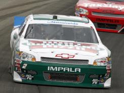 Elliott Sadler drives past Cole Whitt during the NASCAR Nationwide Series race at Chicagoland Speedway in Joliet, Ill.