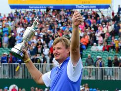 Ernie Els holds up the Claret jug after his surprising victory Sunday in the British Open at Royal Lytham & St Annes.