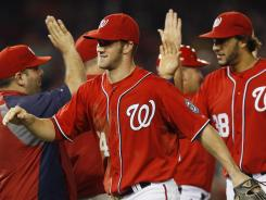 Nationals right fielder Bryce Harper celebrates in the outfield after a 5-2 win over the Atlanta Braves in the second baseball game of a doubleheader.