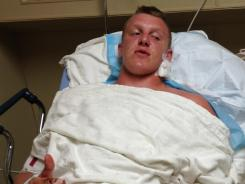 Zach Golditch, shown here at Aurora Medical Center South, suffered a wound below his earlobe when a bullet entered his theater, which was close to the theater where a gunman opened fire during the midnight showing of The Dark Knight Rises in Aurora, Colo.