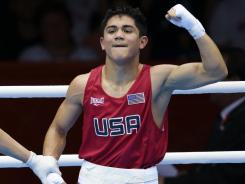 Joseph Diaz Jr. (right) got the USA boxing team off to a good start with a victory in the bantamweight division.