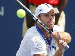 Andy Roddick returns a shot during the final match against Gilles Muller at the Atlanta Open tennis tournament.