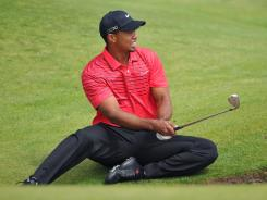 Tiger Woods has to hit a bunker shot from an awkward angle on the sixth hole Sunday, and he ends up with a triple bogey.
