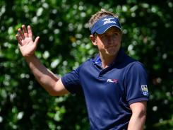 Luke Donald acknowledges the cheers during the final round Sunday at the British Open. He's still looking for his first major title.