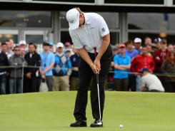 Ernie Els becomes the third champion in the last four majors to win using a belly putter.