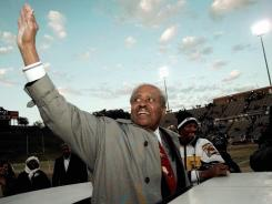 Eddie Robinson waves to the crowd following his last home game at Grambling in November 1997.