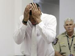 Darrell Williams, left, weeps as he is escorted from the courtroom in Stillwater, Okla., after being convicted of sexual battery and rape by instrumentation.