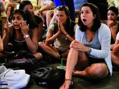 Disbelief: Sophomore Laura Lovins, right, and other Penn State students react after sanctions against the football program are announced Monday.