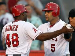 Albert Pujols, right, is congratulated by Torrii Hunter after hitting a two-run homer in the seventh inning.