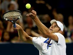 Andy Roddick serves to John Isner during the semifinals of the Atlanta Open on July 21. Roddick won the tournament and now turns his focus to the Olympics at London.
