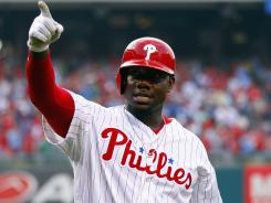 Ryan Howard gestures after hitting a home run in the first inning against the Milwaukee Brewers.