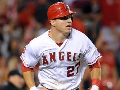 Angels rookie Mike Trout, watching his home run vs. the Rangers on July 20, has MVP-type numbers now, but expect them to drop slightly as the season progresses.