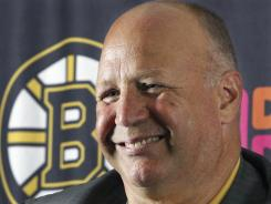 Bruins coach Claude Julien smiles after it was announced he was granted a long-term contract extension Tuesday.