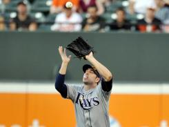 Rays right fielder Matt Joyce catches a pop-up by Orioles right fielder Nick Markakis in the first inning at Oriole Park at Camden Yards.
