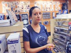 Caroline Gummo is advertising manager for The Family Clothesline in State College, Pa. The store sells many types of Penn State merchandise. She theorizes that the ripple effect of the NCAA sanctions on local businesses might not be known for a couple of years.