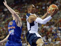 U.S. guard Russell Westbrook, right, drives past Spain forward Victor Claver during the second half of an exhibition game Tuesday in Barcelona.