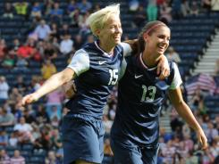 Midfielder Megan Rapinoe, left, celebrates with forward Alex Morgan, who scored twice in the USA's 4-2 victory against France.