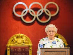 Britain's Queen Elizabeth II speaks at a reception for members of the International Olympic Committee, at Buckingham Palace, Monday, July 23, 2012, in London. Opening ceremonies for the 2012 London Olympics will be held Friday, July 27.