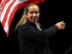 Mariel Zagunis, a two-time gold medalist in fencing, won a vote of U.S. team members and will carry the flag on Friday in the London Games opening ceremony.