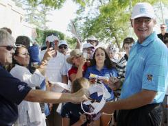 Another week, another tournament: Ernie Els, fresh off his win in the British Open on Sunday, spends time with Canadian Open fans ahead of that tournament, which starts today. Els tees off at 1:10 p.m. ET.