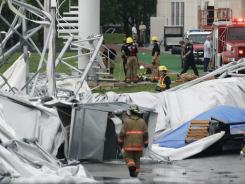 In this Saturday, May 2, 2009, file photo, firefighters investigate the collapsed canopy that covered the Dallas Cowboys indoor football facility in Irving, Texas.