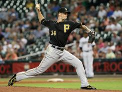 Pittsburgh Pirates pitcher A.J. Burnett pitches in the fourth inning against the Houston Astros.