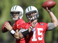 Tim Tebow (15) and Mark Sanchez. Can the Jets' experiment work, or will it fail miserably?