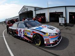Tony Stewart's No. 14 Chevrolet is pushed through the Pocono Raceway garage area last month during Sprint Cup qualifying.