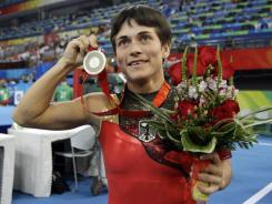 Germany's Oksana Chusovitina poses after winning the silver medal in the women's vault finals at the 2008 Olympics in Beijing. Chusovitina, 37, is a vault favorite again in London.