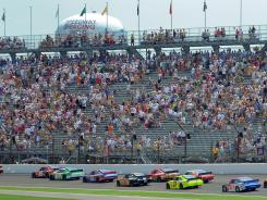 The field of 43 drivers sails between Turns 1 and 2 at the start of last year's Brickyard 400, which drew an estimated 138,000 fans (down from 280,000 in 2005).